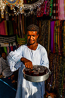 Man serving tea at a shop in Kom Ombo, Egypt.