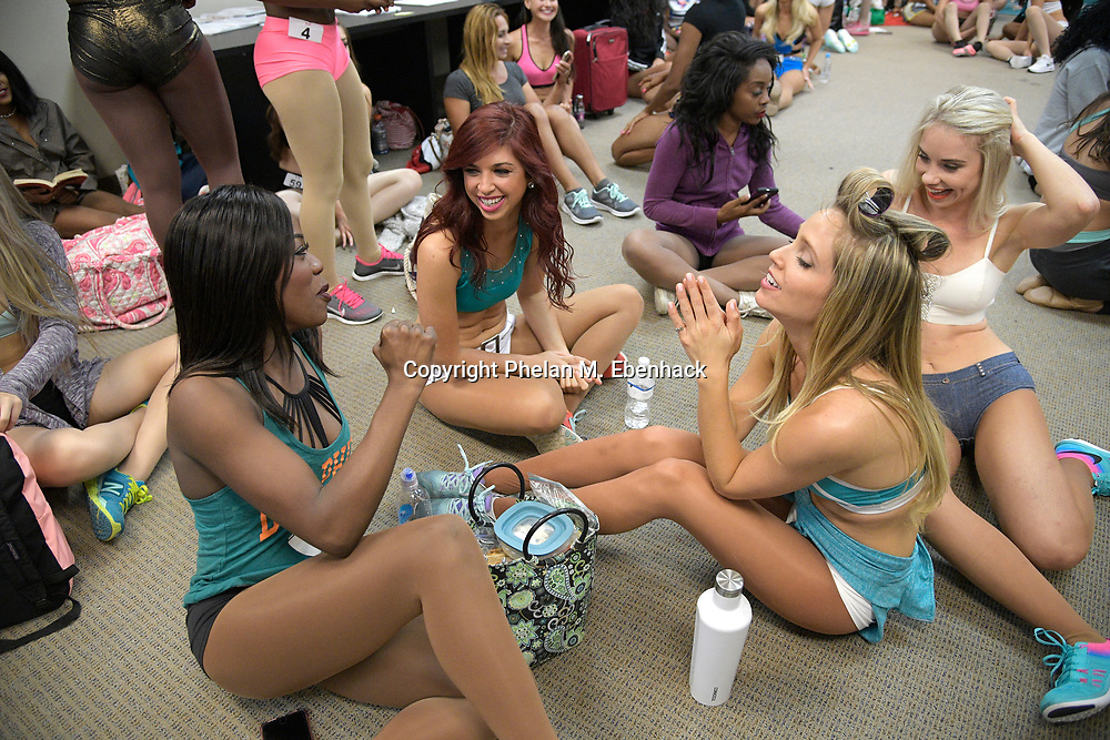 Contestants who were among those selected to attend the final tryout for the Miami Dolphins Cheerleaders squad react after their names were called out Saturday, May 6, 2017 in Orlando, Fla. The final tryout will be held in Miami in June. (Photo by Phelan M. Ebenhack)