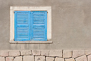 Bright blue window shutters in the small mining town of San Antonio de los Cobres, in northern Argentina.
