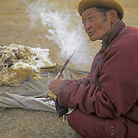MONGOLIA, Darhad Valley.  Nomadic elder with his traditional pipe.