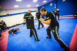 Students working pads as Stef Noij, KMG Instructor from the Institute Krav Maga Netherlands, takes the IKMS G Level Programme seminar today at the Scottish Martial Arts Centre, Alloa.