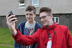 Teenage boys with mobile phone