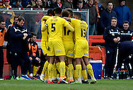 Plymouth players celebrate Reuben Reid's opening goal during the Sky Bet League 2 match between Cheltenham Town and Plymouth Argyle at Whaddon Road, Cheltenham, England on 28 March 2015. Photo by Alan Franklin.