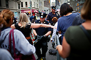 Police are controlling people in Lower Manhattan, New York, USA, on the 10th anniversary of the 9/11 attacks on the Word Trade Centre.