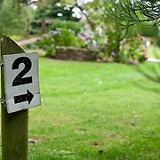 2 number arrow sign in garden
