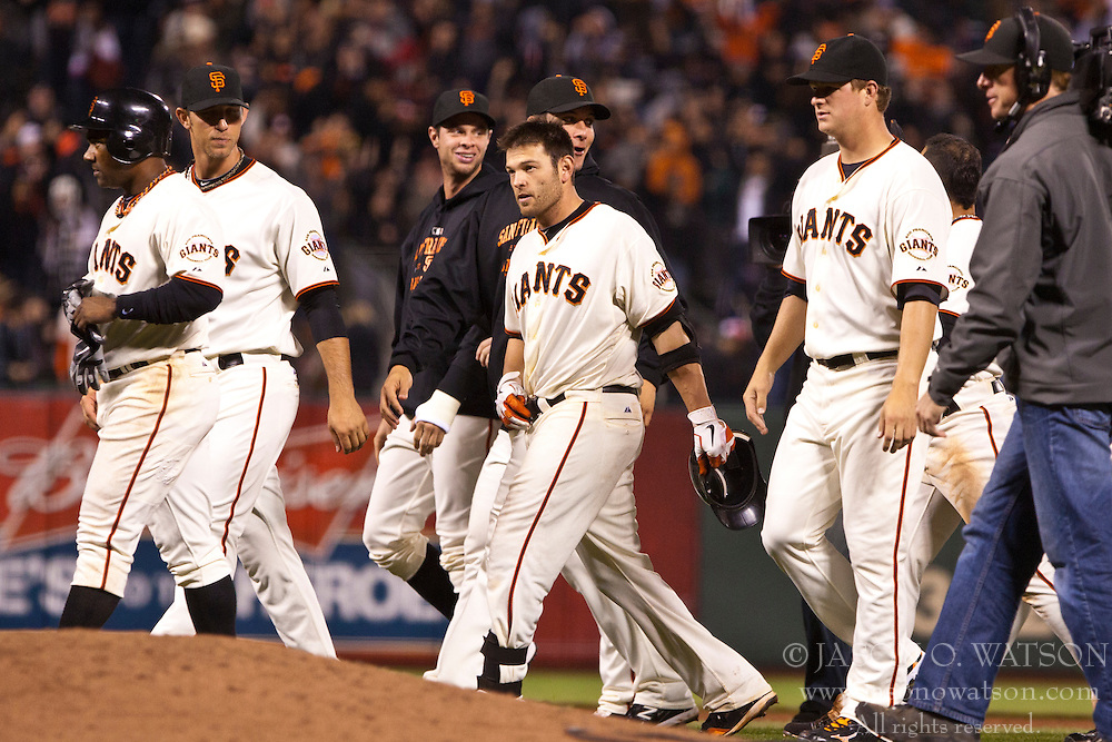 June 6, 2011; San Francisco, CA, USA;  San Francisco Giants second baseman Freddy Sanchez (center) celebrates with teammates after hitting the game winning single against the Washington Nationals during the thirteenth inning at AT&T Park.  San Francisco defeated Washington 5-4 in 13 innings.