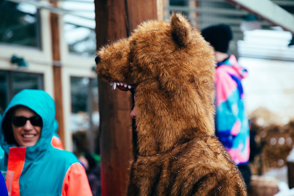 Twenty Canadians and a guy in a bear suit hang outside of the Mangy Moose in Teton Village, Jackson Hole Mountain Resort, Wyoming.