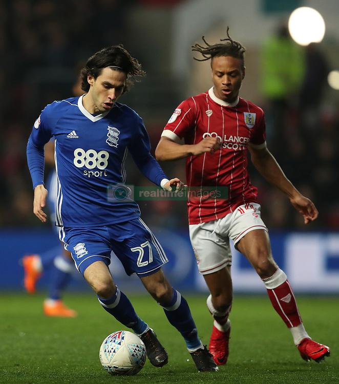 Bristol City's Bobby Reid  and Birmingham City's Jota