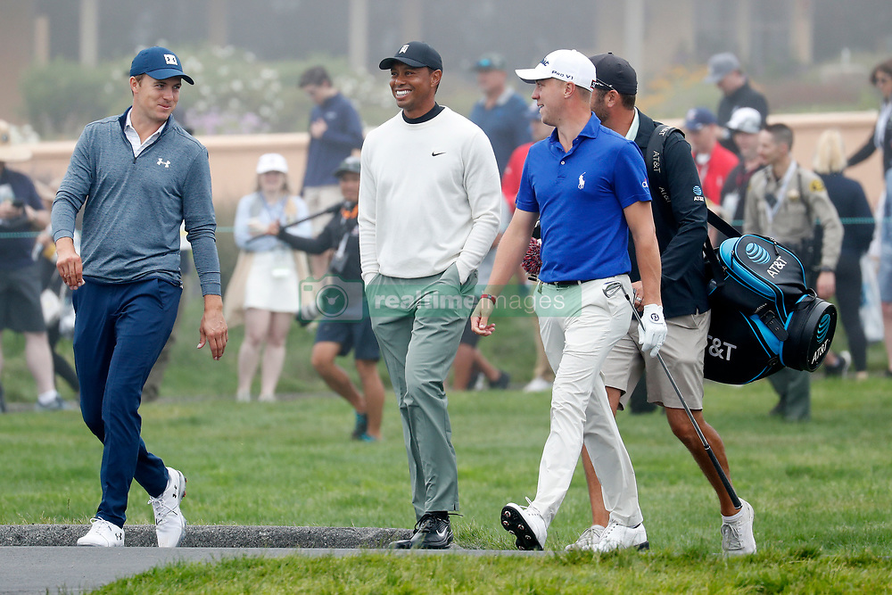 June 12, 2019 - Pebble Beach, CA, U.S. - PEBBLE BEACH, CA - JUNE 12: From left to right PGA golfers Jordan Spieth and Tiger Woods and Justin Thomas walk the 16th hole during a practice round for the 2019 US Open on June 12, 2019, at Pebble Beach Golf Links in Pebble Beach, CA. (Photo by Brian Spurlock/Icon Sportswire) (Credit Image: © Brian Spurlock/Icon SMI via ZUMA Press)