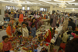November 3, 2018 - Lahore, Punjab, Pakistan - Visitors taking interest on items displayed during (DAACHI) Arts and Crafts Fair exhibition organized by Daachi Foundation at a local hotel. Textiles, pottery, Hunza Shawls, Ethnic Jewelry, crafts from Gilgit, Hyderabadi bangles, Phulkari from Haripur, Taxila stone carvings, hand-painted furniture, food stalls, truck art goods, food stalls, paintings and lots more in this exhibition. (Credit Image: © Rana Sajid Hussain/Pacific Press via ZUMA Wire)