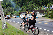 South Pacific, American Samoa, Pago Pago tourists tour on bicycles