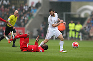 Christian Benteke  of Liverpool is sent tumbling to the ground by Jordi Amat of Swansea city.  Barclays Premier league match, Swansea city v Liverpool  at the Liberty Stadium in Swansea, South Wales on Sunday 1st May 2016.<br /> pic by  Andrew Orchard, Andrew Orchard sports photography.