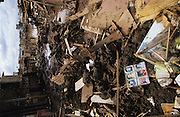 Central America, Honduras, Tegucigalpa. Family photos. Devastation in the aftermath of Hurricane Mitch. High winds and flooding. Infrastructure destroyed.