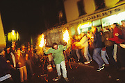 Europe, England, Devon. English Carnival Bonfire Season. They commemorate the attempted destruction of the Houses of Parliment by Guy Fawkes on Nov 5th 'The Gunpowder Plot'. Also the killing of Protestant martyrs by the Catholics, Pagan rites, the world wars and various other historical events. Three months of nightime festivities where local people march through the streets with flaming torches disguised in fancy dress. Photograph © Nigel Dickinson