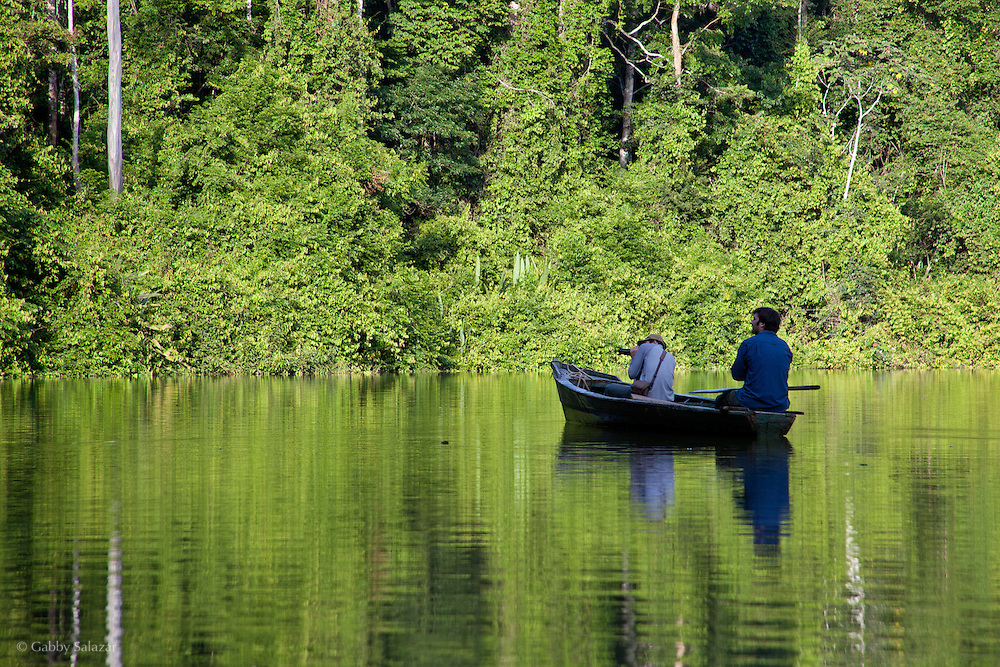 Gabriel Chait and his assistant Pablo canoeing on Cocho Lobo, an oxbow lake that was formerly part of Rio Los Amigos. Los Amigos Conservation Concession run by the Amazon Conservation Association and the Asociación para la Conservación de la Cuenca Amazónica. The concession is on the Rio Madre de Dios and the Rio Los Amigos. It protects lowland rainforest in the Los Amigos - Tambopata Conservation Corridor and has a biological research station called CICRA.