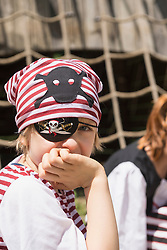 Portrait of a boy dressed up as a pirate in adventure playground, Bavaria, Germany