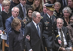 Former United States President George W. Bush, center, and former first lady Laura Bush, escorted by Major General Michael L. Howard, Commanding General, Joint Force Headquarters-National Capital Region, arrive for the National funeral service in honor of the late former United States President George H.W. Bush at the Washington National Cathedral in Washington, DC on Wednesday, December 5, 2018.<br /> Photo by Ron Sachs / CNP/ABACAPRESS.COM