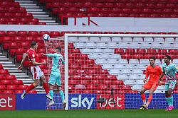 Ryan Yates of Nottingham Forest heads towards goal, despite the challenge of Matt Grimes of Swansea City  - Mandatory by-line: Nick Browning/JMP - 29/11/2020 - FOOTBALL - The City Ground - Nottingham, England - Nottingham Forest v Swansea City - Sky Bet Championship
