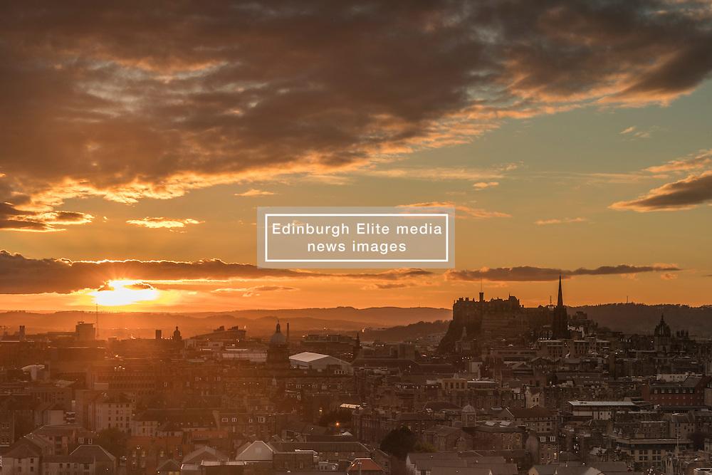 The sun sets over Edinburgh