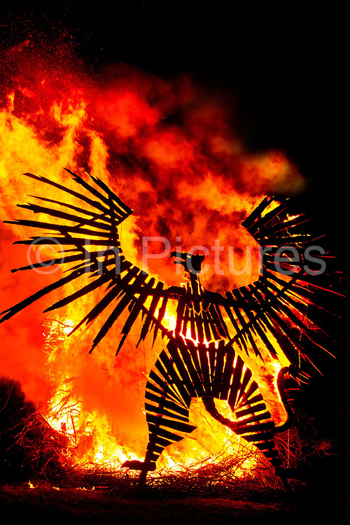 Glastonbury Festival, 2015.<br /> The festival opens with fire rituals and fireworks launched from near the stone circle: a huge 30ft phoenix rises from the ashes during a spectacular bonfire.