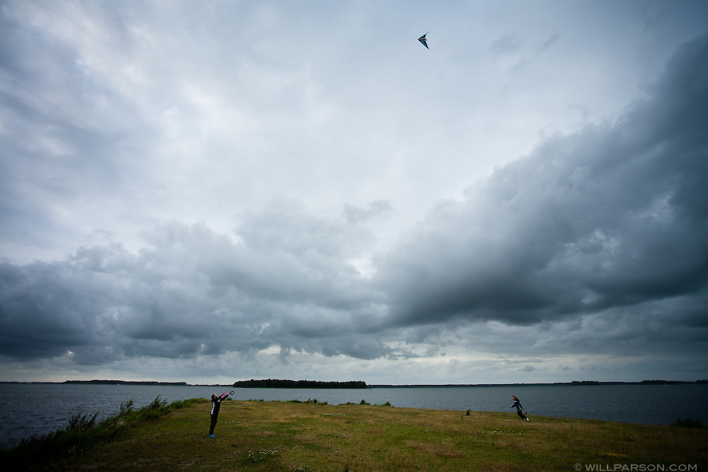 Visitors fly a kite at Bad Hoophuizen campground in Hulshorst, Netherlands, July 8, 2009.