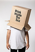 Man with box on his head, think inside the box. Concept