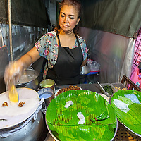 Woman cooking thai sweets at the night market in Hua Hin.