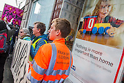 Anti-Fracking protesters target HSBC in global day of action. Mock Drill Rig, 'fracked water', hazard tape and speakers from affected communities turn two Central London HSBCs are turned into 'live fracking sites' in protest about funding to fracking. 'Global Frackdown' day of action sees 100s of actions against fracking in over 30 countries.The Strand, London. 11 Oct 2014.Guy Bell, 07771 786236, guy@gbphotos.com