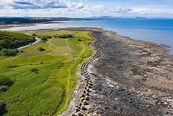 Aerial view of Second World War era anti-tank blocks on shore at Gosford Sands at Longniddry in East Lothian, Scotland, UK