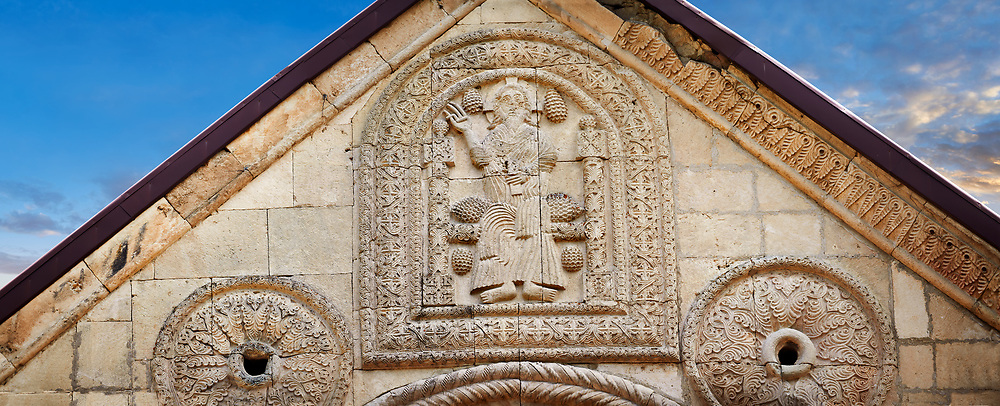 Pictures & images of Nikortsminda ( Nicortsminda ) St Nicholas Georgian Orthodox Cathedral exterior and its Georgian relief sculpture stonework depicting a saint, probably St Nicholas, above the main entrance, 11th century, Nikortsminda, Racha region of Georgia (country). A UNESCO World Heritage Tentative Site. .<br /> <br /> Visit our MEDIEVAL PHOTO COLLECTIONS for more   photos  to download or buy as prints https://funkystock.photoshelter.com/gallery-collection/Medieval-Middle-Ages-Historic-Places-Arcaeological-Sites-Pictures-Images-of/C0000B5ZA54_WD0s<br /> <br /> Visit our REPUBLIC of GEORGIA HISTORIC PLACES PHOTO COLLECTIONS for more photos to browse, download or buy as wall art prints https://funkystock.photoshelter.com/gallery-collection/Pictures-Images-of-Georgia-Country-Historic-Landmark-Places-Museum-Antiquities/C0000c1oD9eVkh9c