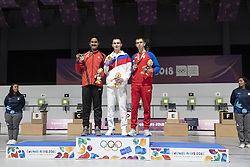 BUENOS AIRES, Oct. 8, 2018  Gold medalist Grigorii Shamakov (C) of Russia, silver medalist Shahu Tushar Mane (L) of India and bronze medalist Aleksa Mitrovic of Serbia pose for photos during the awarding ceremony of the Men's 10m Air Rifle Final at the 2018 Summer Youth Olympic Games in Buenos Aires, capital of Argentina, Oct. 7, 2018. (Credit Image: © Li Ming/Xinhua via ZUMA Wire)