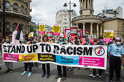 Supporters of Stand Up To Racism join thousands of people attending a United Against The Tories national demonstration organised by the People's Assembly Against Austerity in protest against the policies of Prime Minister Boris Johnson's Conservative government on 26th June 2021 in London, United Kingdom. The demonstration contained blocs from organisations and groups including Palestine Solidarity Campaign, Stand Up To Racism, Stop The War Coalition, Extinction Rebellion, Kill The Bill and Black Lives Matter as well as from trade unions Unite and the CWU.