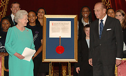 File photo dated 16/11/06 of the Duke of Edinburgh accepting a Royal Charter from Queen Elizabeth II on behalf of his awards scheme during a reception at Buckingham Palace. The Duke of Edinburgh's Award is likely to be judged Prince Philip's greatest legacy. Issue date: Friday April 4, 2021.