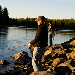 A couple fly-fishing on the Moose River in Rockwood Maine USA