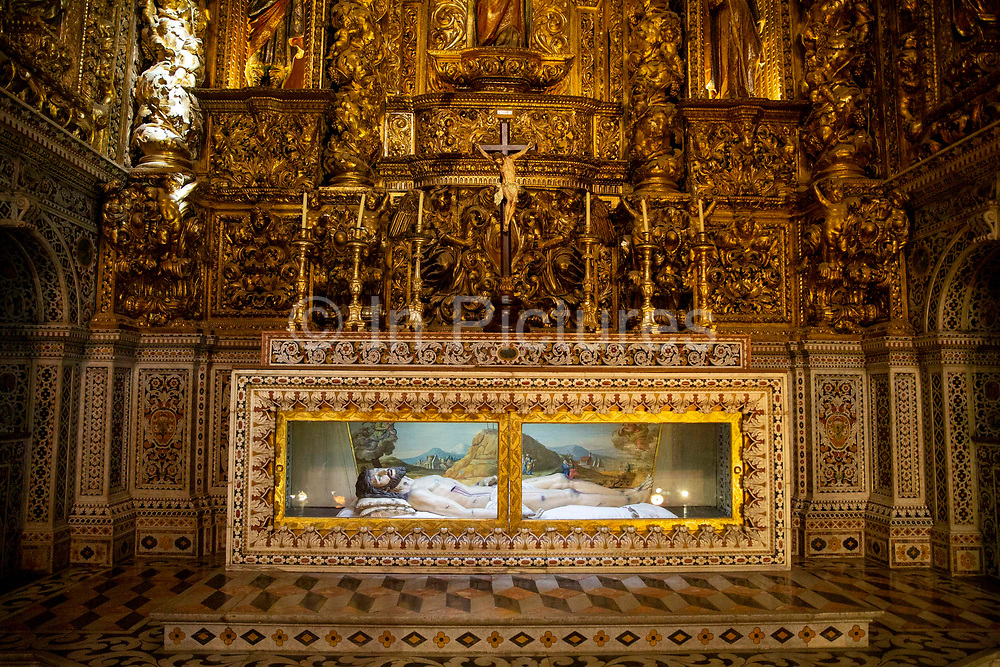 A statue of the body of Jesus Christ set in a beautiful gold glass sided casket on the 29th of October 2019, inside the Church of Sao Roque or Igreja de Sao Roque, Lisbon, Portugal