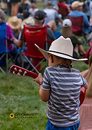 Young fan with toy guitar at the Under The Big Sky Music Festival in Whitefish, Montana, USA