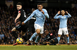 Manchester City's Gabriel Jesus (centre) has a shot on goal during the Premier League match at the Etihad Stadium, Manchester.