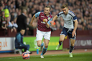 Tom Cleverley of Aston Villa is challenged by James Morrison of West Bromwich Albion. The FA cup, 6th round match, Aston Villa v West Bromwich Albion at Villa Park in Birmingham, Midlands on Saturday 7th March 2015<br /> pic by John Patrick Fletcher, Andrew Orchard sports photography.