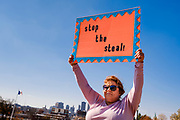 """07 NOVEMBER 2020 - DES MOINES, IOWA: A person holds up a """"Stop the Steal"""" sign during a """"Stop the Steal"""" rally at the Iowa State Capitol. There were rival election rallies at the State Capitol in Des Moines Saturday. About 1,000 supporters of President Donald Trump gathered on the steps of the State Capitol and called for an end to vote counting. About 300 supporters of President Elect Joe Biden gathered in People's Plaza, on the south lawn of the Capitol, and called for the vote count to continue until every vote was counted.      PHOTO BY JACK KURTZ"""