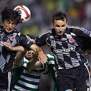 Besiktas's Tomas SIVOK (R) and Ibrahim TORAMAN (L) during their Turkish soccer super league match Bursaspor between Besiktas at Ataturk Stadium in Bursa Turkey on Sunday, 16 May 2010. Photo by TURKPIX
