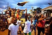 A group of soccer fans are celebrating their team's victory and advancement from second to first division in Guadalupe, a small town near the city of Sao Tome, on the island of Sao Tome, Sao Tome and Principe, (STP) a former Portuguese colony in the Gulf of Guinea, West Africa.