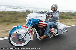 Tim Sutherland of Coastal Indian riding his custom Indian Chieftain beside the Atlantic Ocean during Daytona Beach Bike Week. FL. USA. Monday March 13, 2017. Photography ©2017 Michael Lichter.