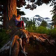 A young girl takes a look at Heather Meadows at sunset near Mount Baker Ski Area Washington.