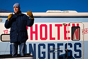 """01 NOVEMBER 2020 - CHARLES CITY, IOWA: Congressional candidate J.D. SCHOLTEN speaks from the back of a pickup truck parked in front of his motorhome during a drive in rally in Charles City, a community in northern Iowa. Scholten, a Democrat from Sioux City, Iowa, is running against Randy Feenstra, a Republican, in the 2020 general election on November 3. Iowa's 4th district, centered in the agricultural and sparsely populated northwest corner of the state, is the largest congressional district in Iowa and encompasses about ⅓ of the state of Iowa. Because of the COVID-19 pandemic Scholten has transitioned to drive rallies rather than in person. Scholten is on his """"Every Town Tour 2020."""" He is visiting all 375 towns in the 39 counties in the district.           PHOTO BY JACK KURTZ"""