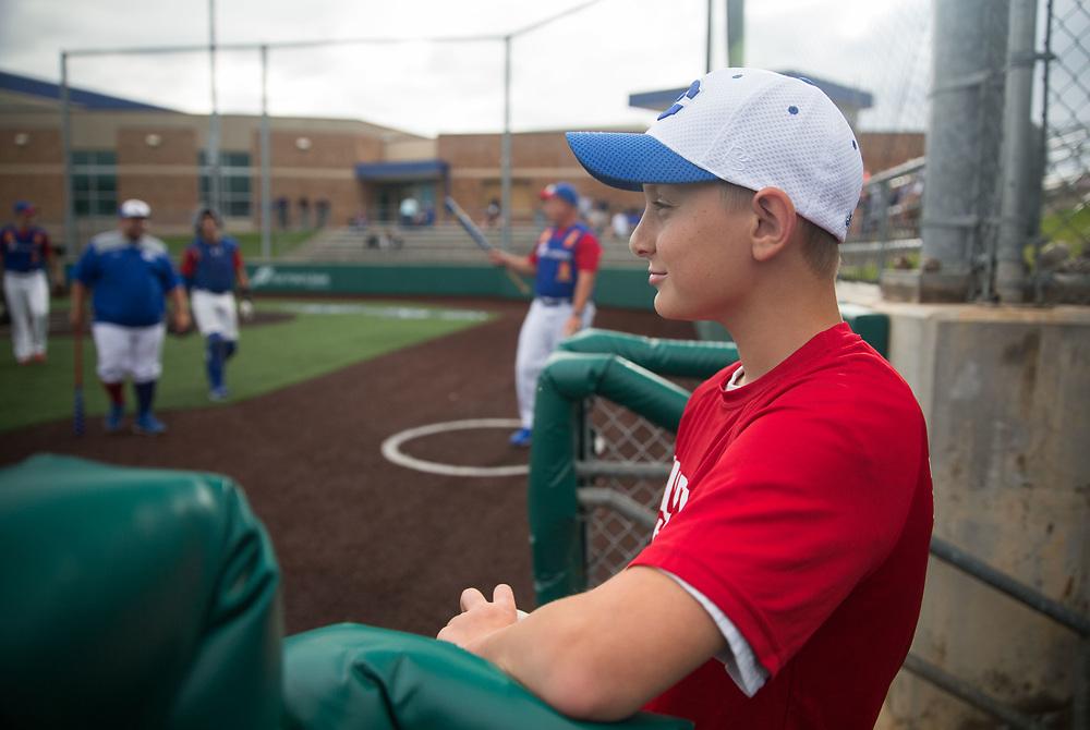 Grayson Gilbert, 11, stands in the dugout. Post 1 Omaha, Nebraska, played Post 307 Renner, South Dakota, in a legion baseball game at Creighton Prep on Wednesday, June 20, 2018, in Omaha, Nebraska.
