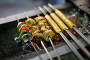 A cook prepares fresh kebabs at Karim's Restaurant, Delhi, India