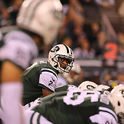 New York Jets Quarterback Geno Smith looks along the line of scrummage at wide receiver Eric Decker during the New York Jets Vs Chicago Bears, NFL regular season game at MetLife Stadium, East Rutherford, NJ, USA. 22nd September 2014. Photo Tim Clayton for the New York Times