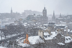 Edinburgh, Scotland, United Kingdom, 1 March, 2018. Heavy snowfalls continue across the city from the storm known as The Beast from the East. Most shops are closed and transport services have been cancelled. Pictured; Blizzard sweeps across city viewed from Calton Hill