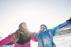 Children with arms outstretched in winter