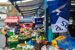 Tottenham flags and bunting adorn Hall's Greengrocers at Holcombe Market in Tottenham ahead of Spur's Champions League final with Liverpool to be played at Atletico Madrid's Wanda Metropolitano Stadium in Madrid. Tottenham, London, May 31 2019.